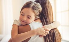 daughter hugs mother tightly