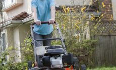 Teenager boy mowing lawn – The benefits of giving your kids chores