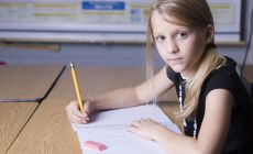 Girl_doing_schoolwork_iStock_000003921893_Large.jpg