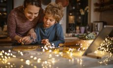 adult and child working on craft project, sparkling lights